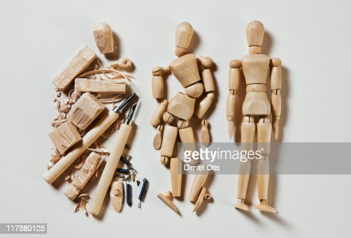 Three wood mannequins in stages of production : Stock Photo