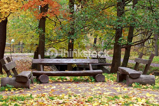 Three Wooden Benches In The Autumn Park Stock Photo Thinkstock