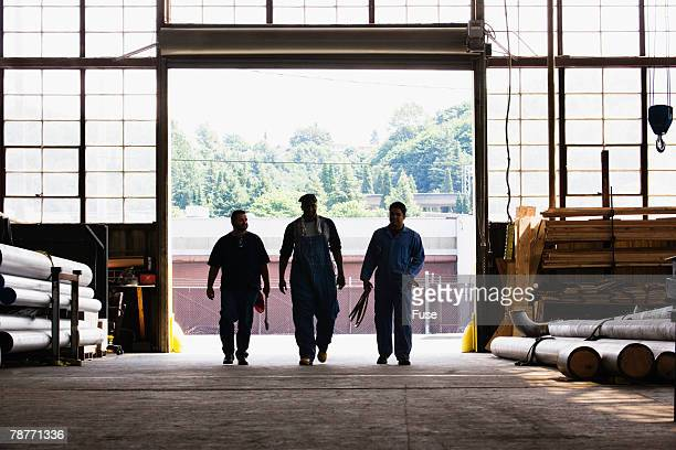 Three Workers Entering Factory