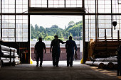 Three Workers Leaving Factory