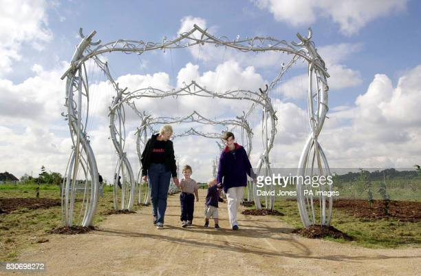Three year old Alix Seal and David Beck aged 18 months walk with their mothers Deborah and Cathy respectively through the 'Rose Arches' sculpture...