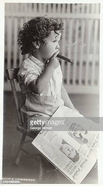 Three year old Bobby Quigley son of Mr and Mrs Edward Quigley in spite of the Board of Public Welfare is thriving well on his cigars before after and...