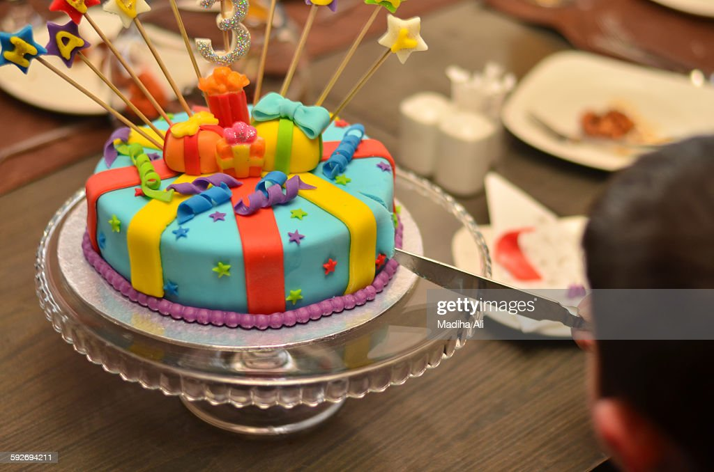 A Three Year Old Boy Cutting His Birthday Cake Stock Photo Getty