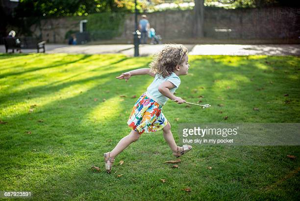 A three year old playing in the park