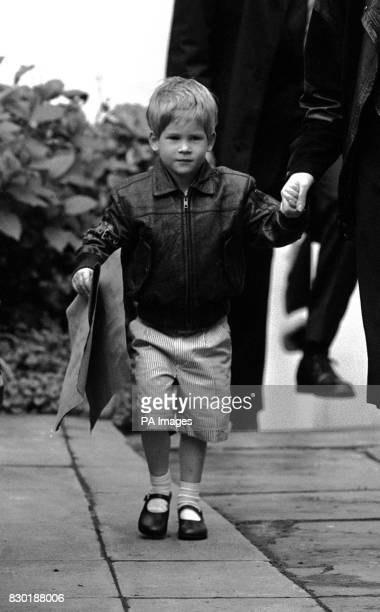 Three year old Prince Harry wears a pair of fashionable stripy Bermuda shorts and a leather bomber jacket for his first day back at school after a...
