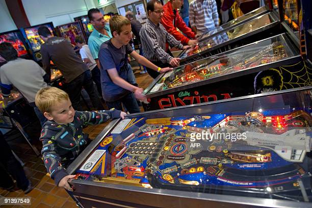 Three year old Xandro from Eindhoven The Netherlands is the youngest participant of the Dutch Pinball Open on October 4 2009 in Veldhoven The...