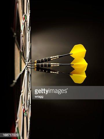 Three Yellow Darts in a Dartboard