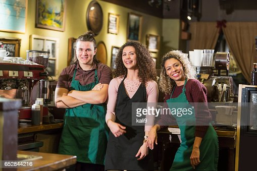 Three young adults working in a coffee shop : Stock Photo