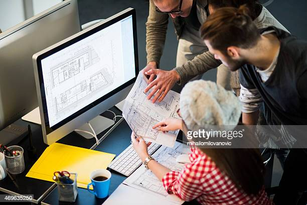 Three young architects at work