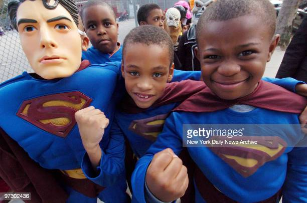Three young boys dressed as Superman show their muscle as students from Public School 193 in Midwood Brooklyn take part in the annual Halloween...