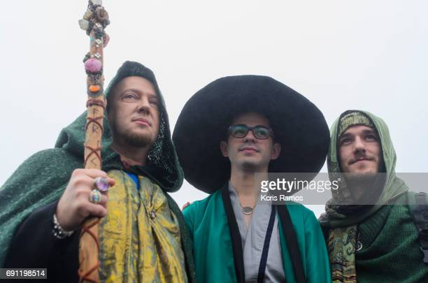 Three young boys with cosplayer of Harry Potter with white background on clear day and null at the festival of witches in Brazil