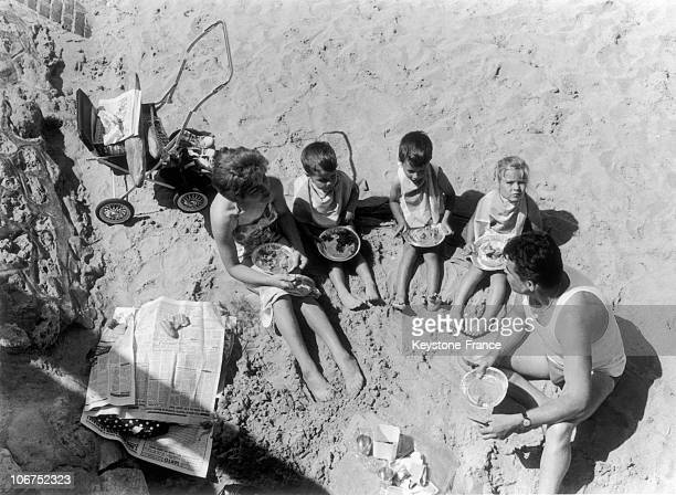 Three Young Children PickNicked On The Beach With Their Parents In Deauville August 1967