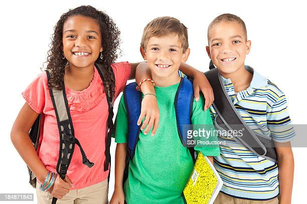 Three young children ready for school