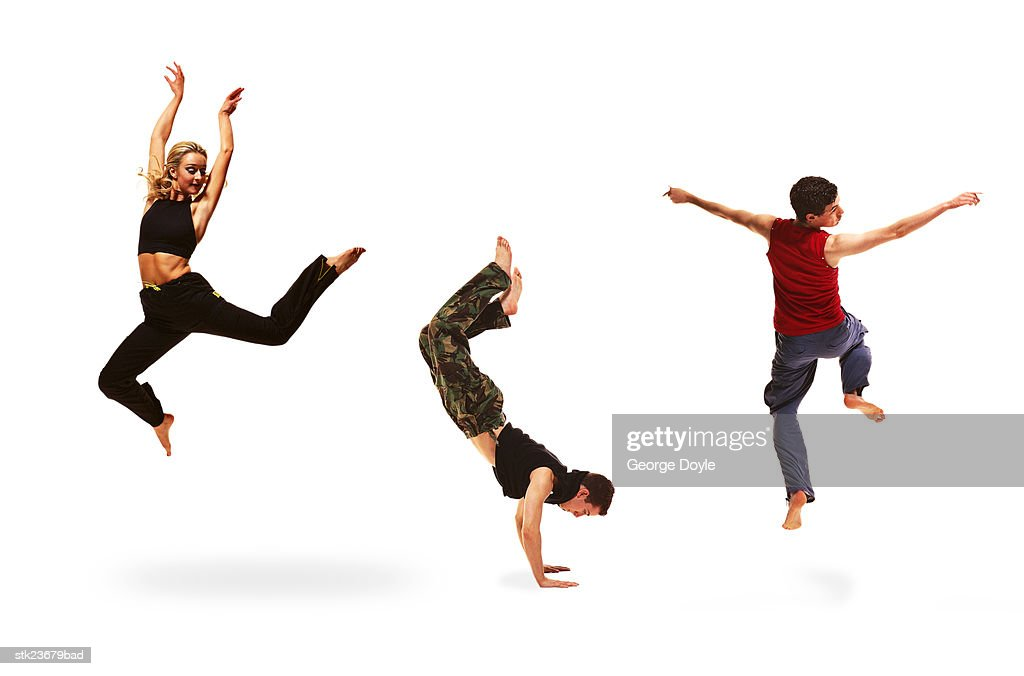 three young dancers performing : Stock Photo