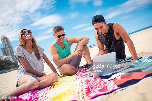 Three young friends having fun on the beach