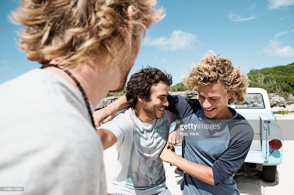 Three young friends on beach : Stock Photo
