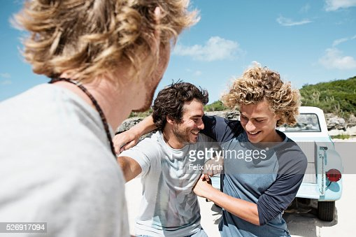 Three young friends on beach : Stockfoto