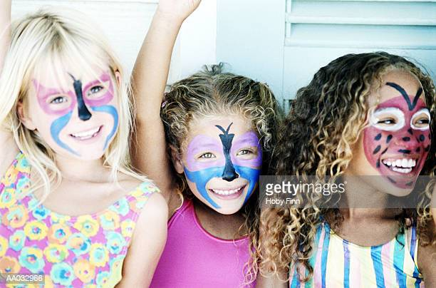 Three Young Girls with Painted Faces