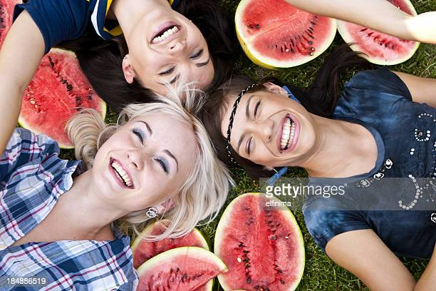 Three young girls with watermelon