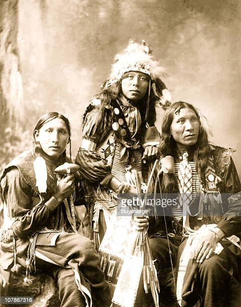 Three young Indian men probably Sioux wearing native accessories 1899