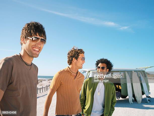 Three young men on the beach