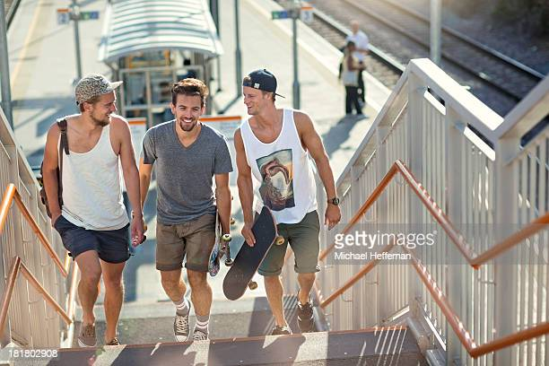 Three young men walking from train station