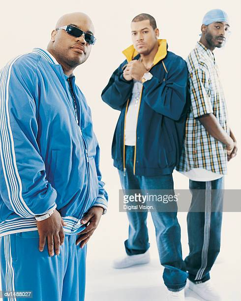 Three Young Men With Attitude Wearing Casual Clothing