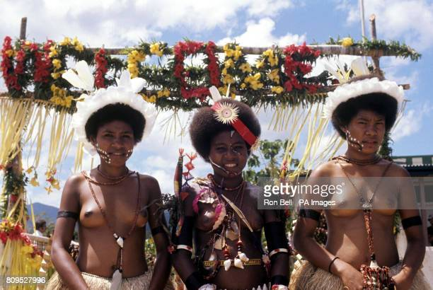 Three young Papuan girls who were the Royal car attendants for the visit of Queen Elizabeth II and the Duke of Edinburgh to Alotau Gemma Ganisi 16...