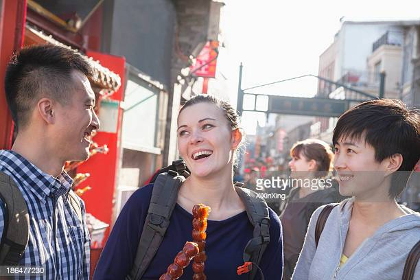 Three young people with candied haw.