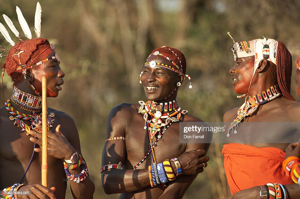 Three young Samburu warriors in costume, conversing, close-up : Stock Photo