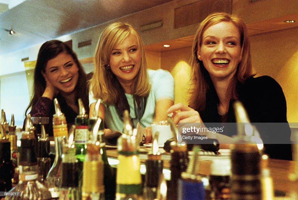 Three young women at  Bar, Smiling