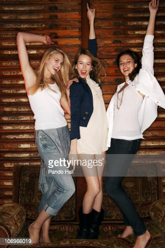 Three young women dancing and laughing : Stock Photo
