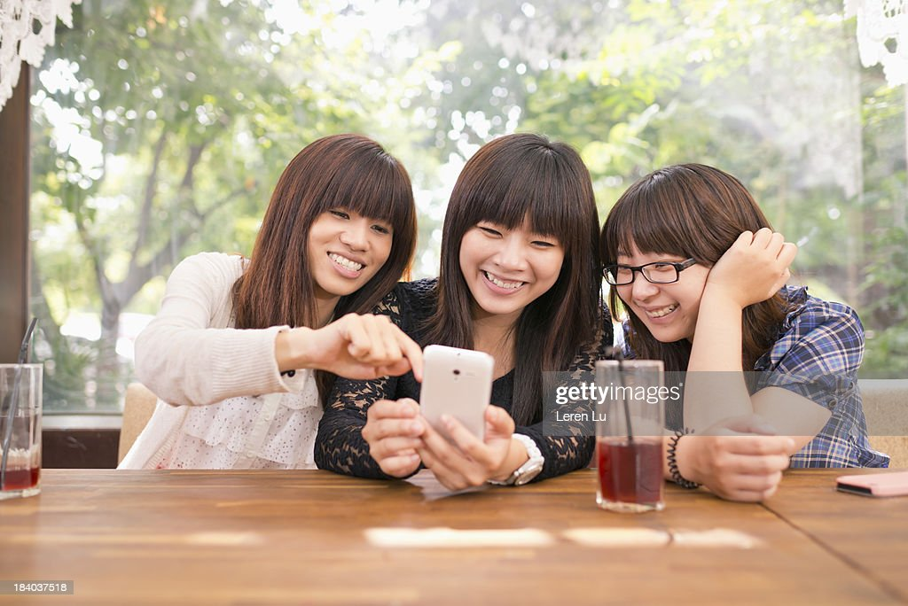 Three young women get together : Stock Photo