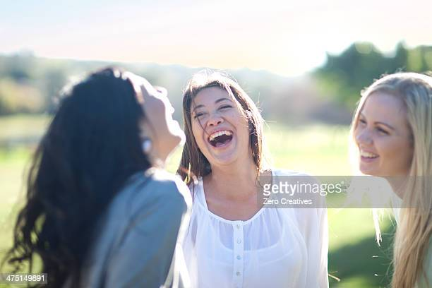 Three young women having fun in park