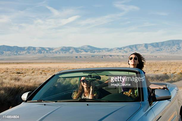 Three young women in convertible car