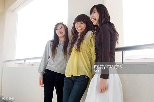 Three Young Women in Corridor