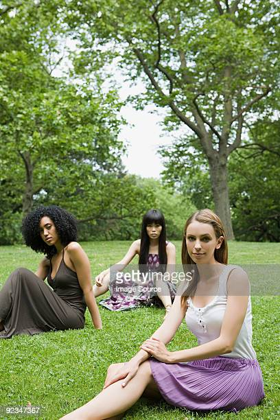 Three young women in park