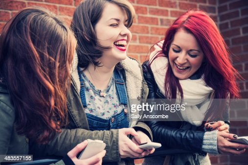 Three young women laughing together : Stock Photo