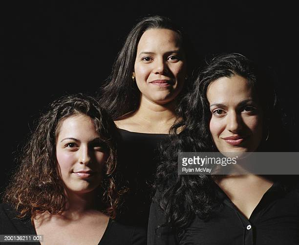 Three young women smiling, portrait