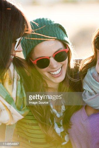 Three young women wearing sunglasses, portrait : Stock Photo