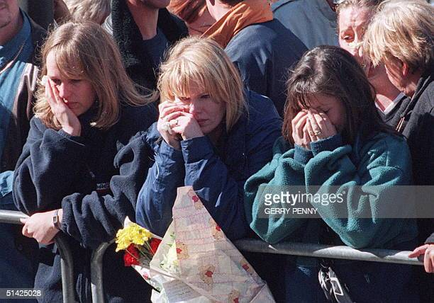 Three young women weep during the funeral procession of Diana Princess of Wales in London 06 September Diana was killed in a car accident in Paris 31...