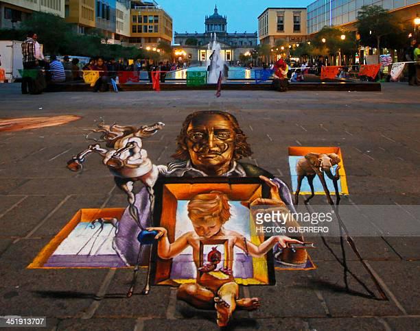 A threedimension painting depicting images of Spanish artist Dali on display at the Plaza Tapatia in Guadalajara City Mexico on November 24 2013 as...