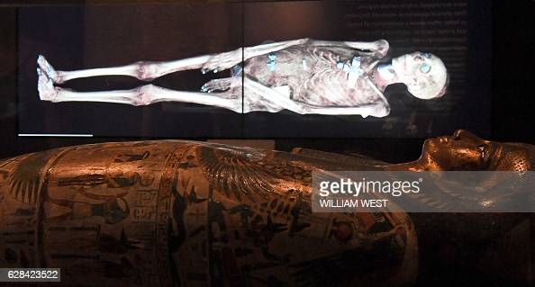 A threedimensional image of a CT scan of an Egyptian mummy is projected above a sarcophagus as the hidden secrets of Egyptian mummies up to 3000...