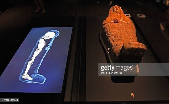 A threedimensional image of a CT scan of an Egyptian mummy is projected beside a sarcophagus as the hidden secrets of Egyptian mummies up to 3000...