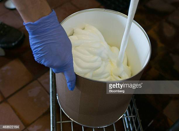 A threegallon tub is filled with Riesling ice cream at Mercer's Dairy in Boonville New York US on Friday July 25 2014 Mercer's Dairy ships its...