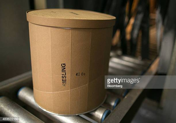 A threegallon tub of Riesling ice cream moves along along a conveyor to the refrigerator at Mercer's Dairy in Boonville New York US on Friday July 25...