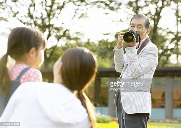 Three-generation family taking picture