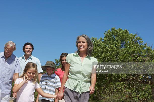 Three-generation family with two children (6-11) walking outdoors