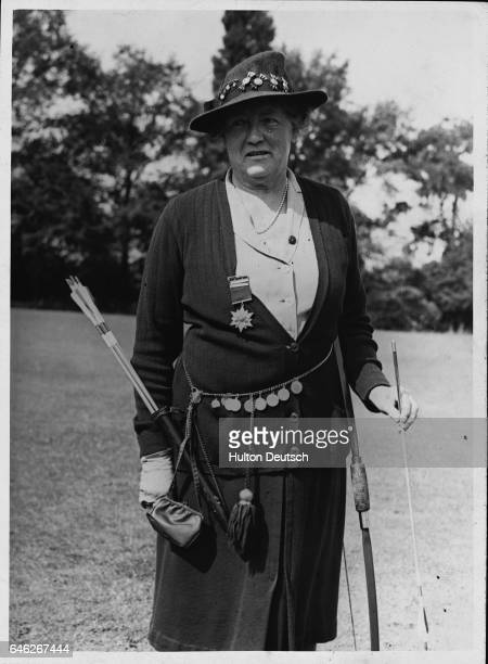 A threequarter length portrait of Mrs Nettleton She was the world champion archer in 1938 and winner of the Jubilee archery meeting held in...