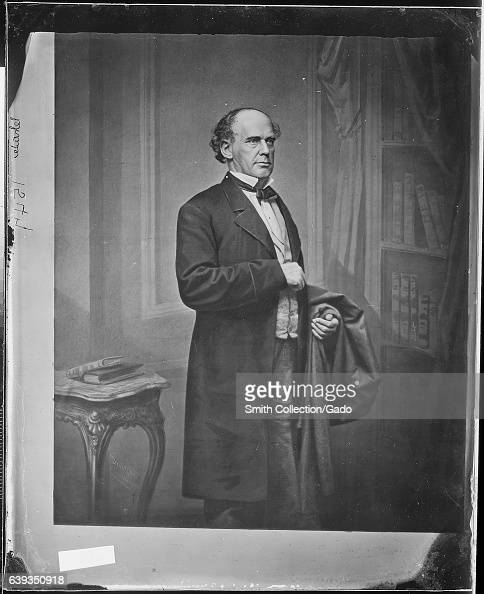 Threequarter length standing portrait of former Chief Justice of the United States Salmon P Chase standing next to a small table 1863 Image courtesy...